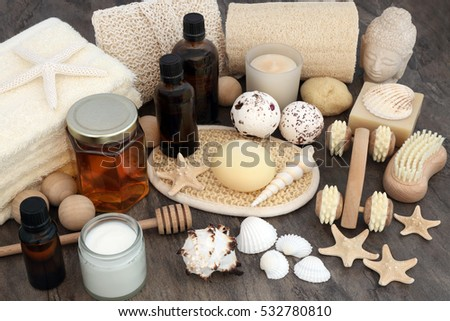 Natural spa and aromatherapy skincare beauty products with bathroom accessories including exfoliating scrubs, oils, sponges, bath bombs, soaps and moisturiser cream.