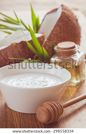 Natural spa coconut essential oil for  therapy. - stock photo