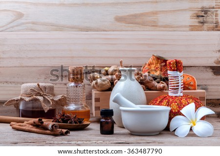 Natural Spa Ingredients herbal compress ball and herbal  Ingredients  for alternative medicine and relaxation thai Spa theme on old wooden background.