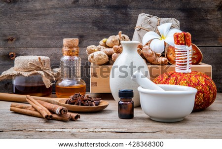 Natural Spa Ingredients herbal compress ball and herbal  Ingredients  for alternative medicine and relaxation - stock photo