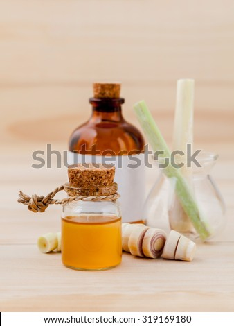 Natural Spa Ingredients lemongrass essential Oil for alternative medicine and aromatherapy. - stock photo