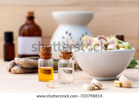 Natural Spa Ingredients Lemongrass essential Oil  with Aromatherapy Burners on wooden background. - stock photo
