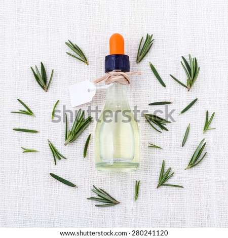 Natural Spa Ingredients  rosemary essential oil for aromatherapy. - stock photo
