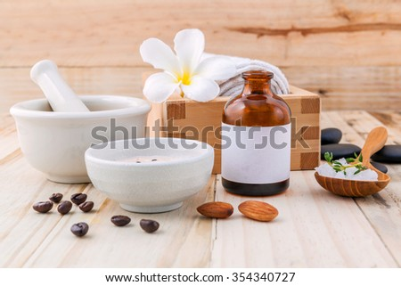 Natural Spa Ingredients sea salt ,coffee beans ,honey , almonds ,spa stones and white mortar on wooden background for scrub and skin care.
