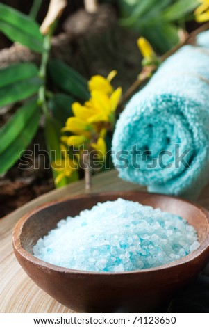 Natural spa setting with bath salt and towel - stock photo