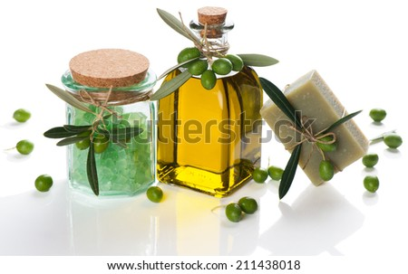 Natural spa setting with olives and olive oil products: bath salt, natural soap and olive oil isolated on white background.  - stock photo