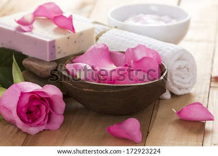 Natural Spa Treatment with Rose on Wooden Background