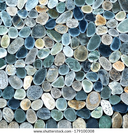 natural stone pebble texture background - surface wall decoration backdrop pattern rock garden - stock photo