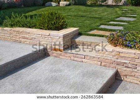 natural stone stairs in a beautiful home garden - stock photo
