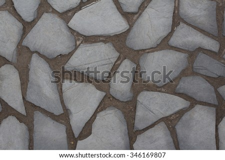 natural stone wall background / stone paved floor
