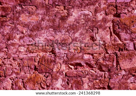 Natural stone wall texture background in trendy marsala color - stock photo