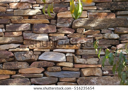 Natural stone wall texture for background.