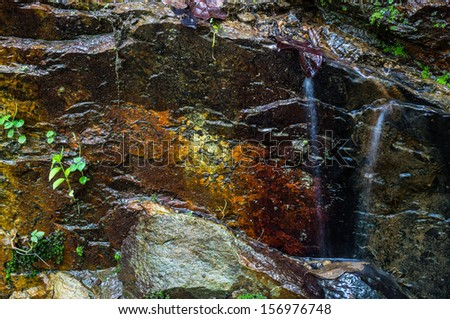 Natural stone wall with running water