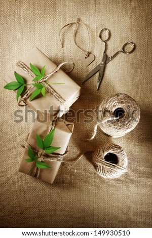 Natural style handcrafted gift boxes with rustic hemp cord spools - stock photo