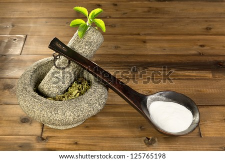Natural sugar substitute Stevia in the form of powder and dried leaves - stock photo