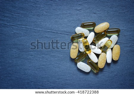 Natural supplements on dark background