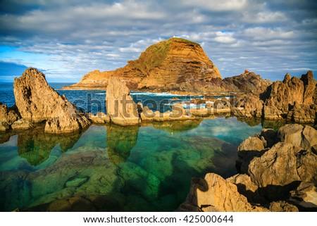 natural swimming pools of volcanic lava in Porto Moniz, Madeira island, Portugal - stock photo