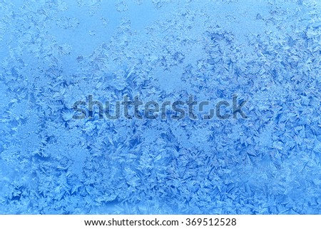 Natural texture of ice pattern on winter glass - stock photo