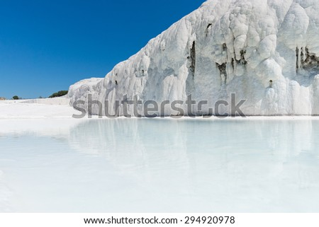 "Natural travertine pools and terraces at Pamukkale ,Turkey. Pamukkale, meaning ""cotton castle"" in Turkish. - stock photo"
