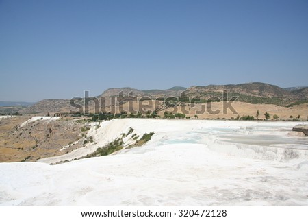 Natural travertine pools and terraces at Pamukkale ,Turkey. Pamukkale, means cotton castle in Turkish. - stock photo