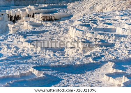 "Natural travertine terraces at Pamukkale ,Turkey. Pamukkale, meaning ""cotton castle"" in Turkish. - stock photo"