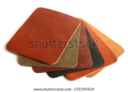 Natural variegated leather on white background - stock photo