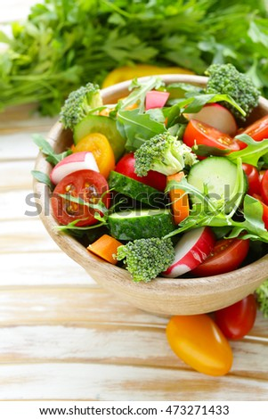 Natural vegetable salad with cucumbers, tomatoes and broccoli