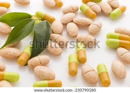 Natural vitamin supplements on the white  background. - stock photo