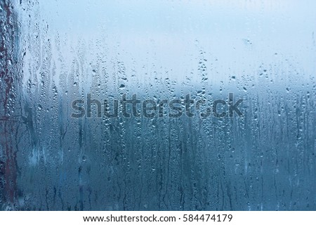 natural water drop background window glass with condensation high humidity large droplets flow down
