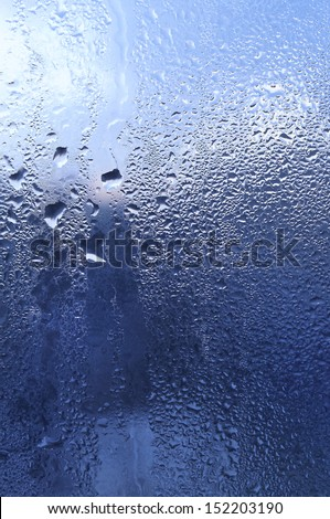 Natural water drops and sunlight on window glass - stock photo