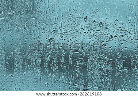 natural water drops on glass window - stock photo