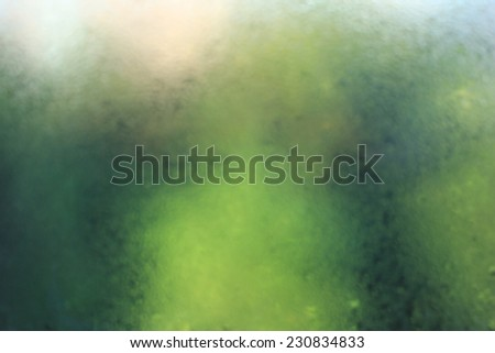 Natural water drops on window glass with nature background
