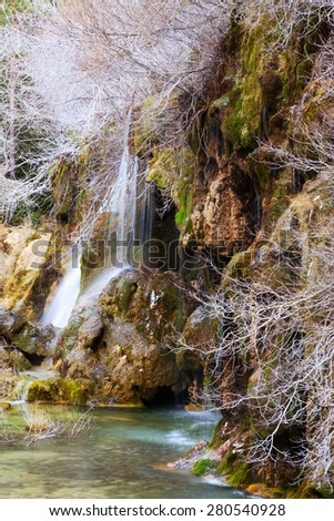 Natural   waterfall at river Cuervo in winter.  Spain - stock photo
