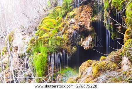 Natural   waterfall at Source of the river Cuervo in winter. Cuenca, Spain - stock photo
