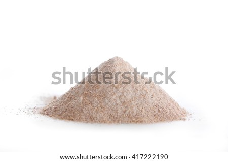 Natural whole wheat flour on white background - stock photo