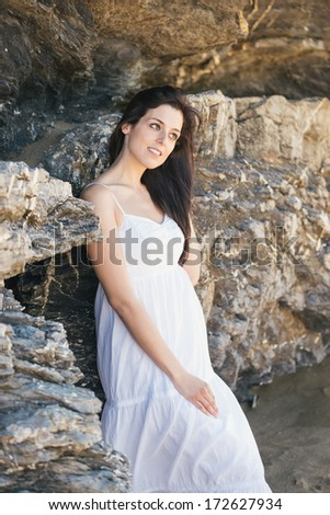 Natural woman summer portrait. Relaxed brunette female outdoor wearing white dress. - stock photo