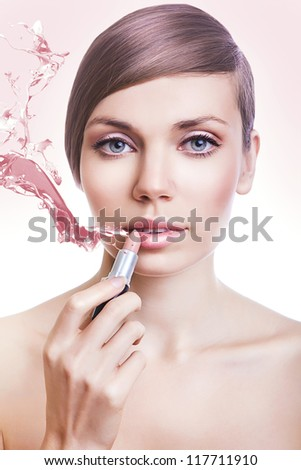 natural woman with pink lipstick and splash