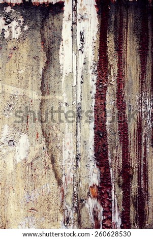 natural wood background with worn and cracked paint aged by time - stock photo