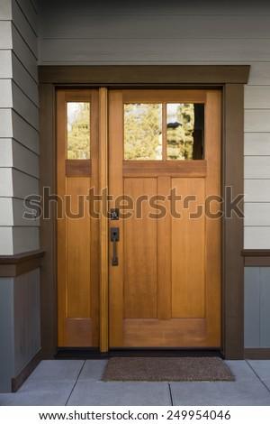 Natural Wood Front Door On Grey Stock Photo 249954046 - Shutterstock