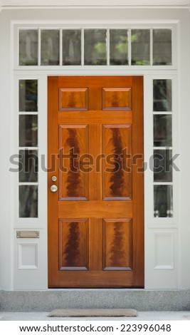 Natural Wood Front Door with White Door Frame and Windows