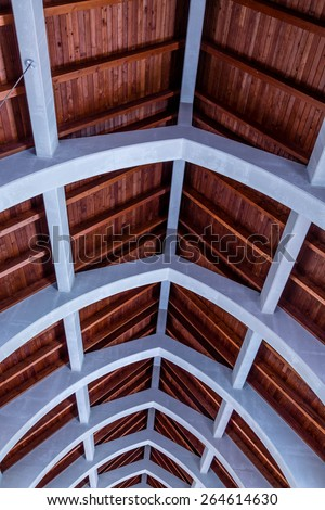 Natural wood roof and cement arched beams in an old abbey at the Monastery of the Holy Spirit in Conyers - stock photo