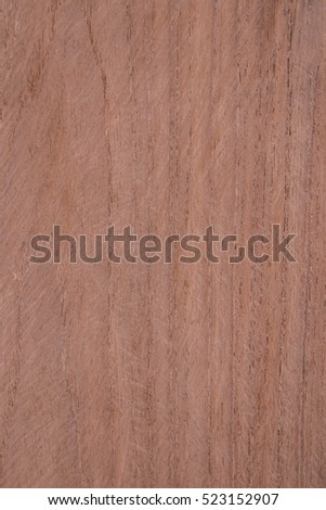 Natural wood texture background. Brown wood texture with natural pattern. Chopping board or floor surface.
