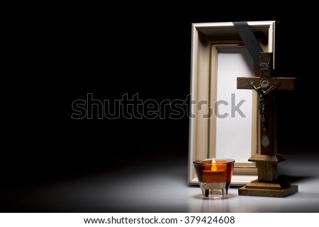 natural wooden mourning frame with candle and crucifix for sympathy card - stock photo