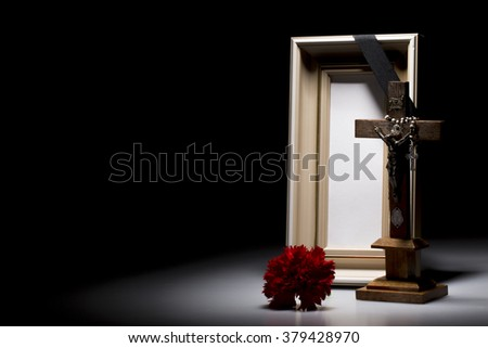 natural wooden mourning frame with crucifix and flower for sympathy card - stock photo