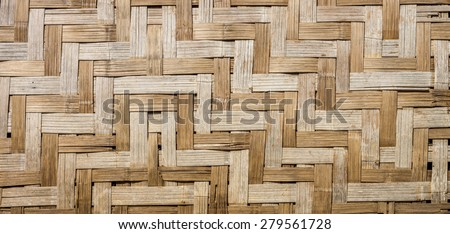 Natural wooden wall is made by bamboo wickerwork of traditional Thai house for interior design