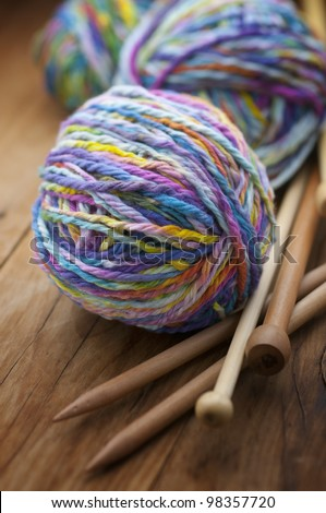 natural wool balls with sticks for hand knitting - stock photo