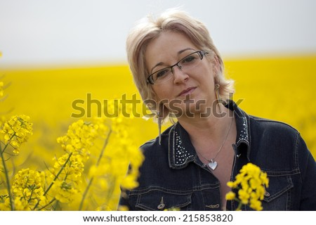 Natural 40 years old woman outdoors - stock photo
