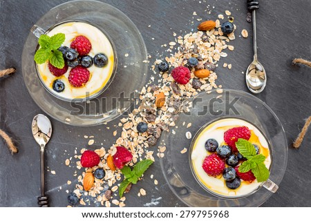 Natural yogurt with fresh berries and muesli, cereal, top view, horizontal composition - stock photo