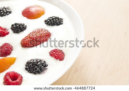 Natural yogurt with fruits and berries in the bowl. Colorful background. Healthy food and lifestyle. Close up view (selective focus)