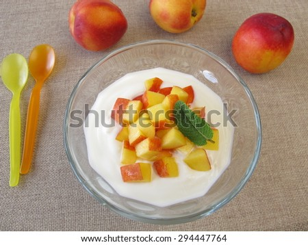 Natural yogurt with nectarines - stock photo